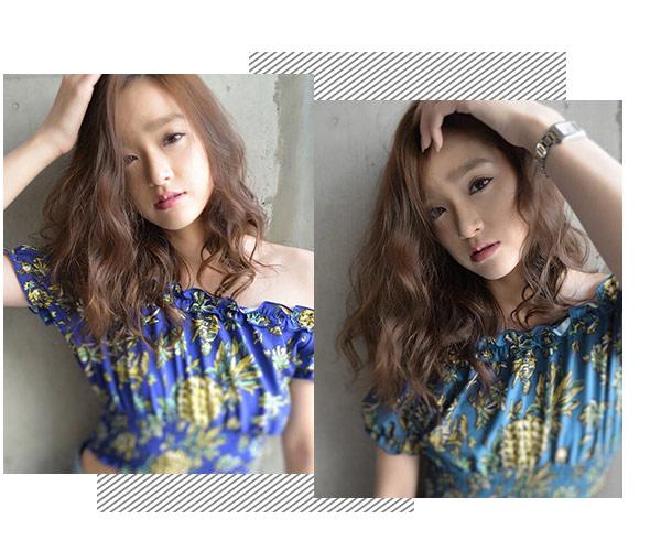 烫发发型的发尾微烫外翘,很好的起到瘦小脸的作用,带有空气感的齐刘海